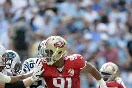 San Francisco 49ers' Arik Armstead (91) makes his move against the Carolina Panthers during the second half of an NFL football game in Charlotte, N.C., Sunday, Sept. 18, 2016. The Panthers won 46-27.  (AP Photo/Bob Leverone)