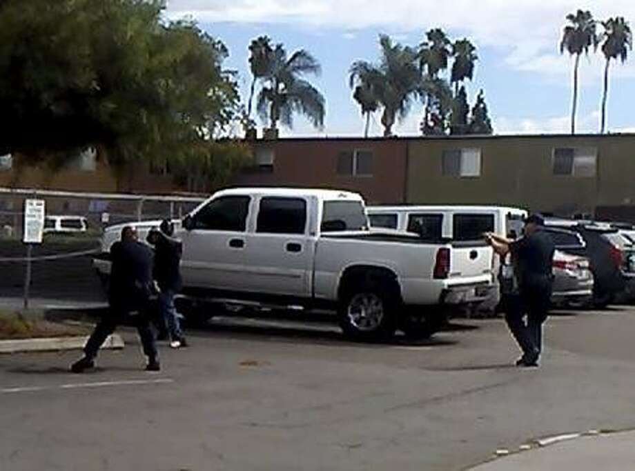 A handout image taken from a video under review by the El Cajon Police Department, shows the scene of an officer-involved shooting of a black man in El Cajon, Calif., on Sept. 27, 2016. The man, identified as Alfred Olango, was walking in traffic and acting �erratically,� according to one individual who called the police. A responding officer fatally shot him after he rapidly pulled an object from his pocket, the police said. (El Cajon Police Department via The New York Times) -- EDITORIAL USE ONLY Photo: EL CAJON POLICE DEPARTMENT, NYT