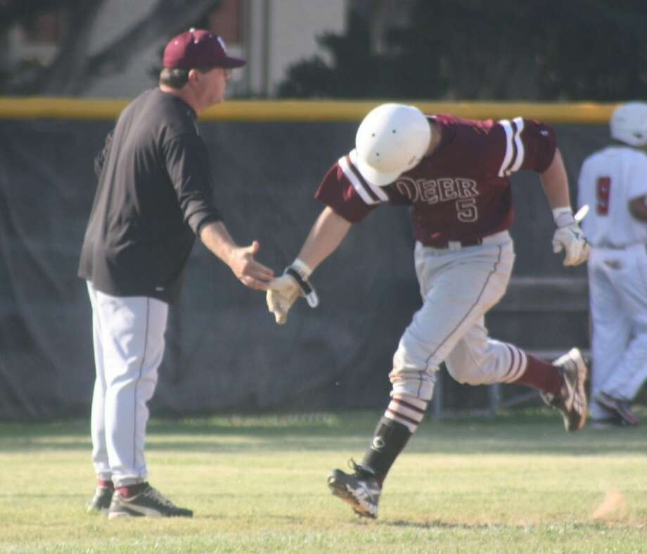 Deer Park head coach Emrick Jagneaux congratulates Logan Taylor after a home run during the 2012 season. Taylor leads Texas A&M with an .853 slugging percentage. Photo: Staff Photo By Robert Avery