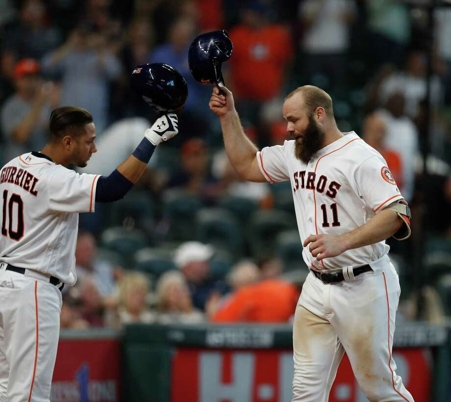 Evan Gattis (11), Yulieski Gurriel and the Astros head to Anaheim with the door all but slammed on their playoff hopes. Photo: Karen Warren, Houston Chronicle / 2016 Houston Chronicle