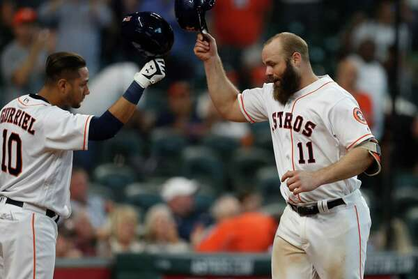 Houston Astros designated hitter Evan Gattis (11) celebrates his home run with Yulieski Gurriel (10) during the sixth inning of an MLB game at Minute Maid Park, Wednesday, Sept. 28, 2016 in Houston.