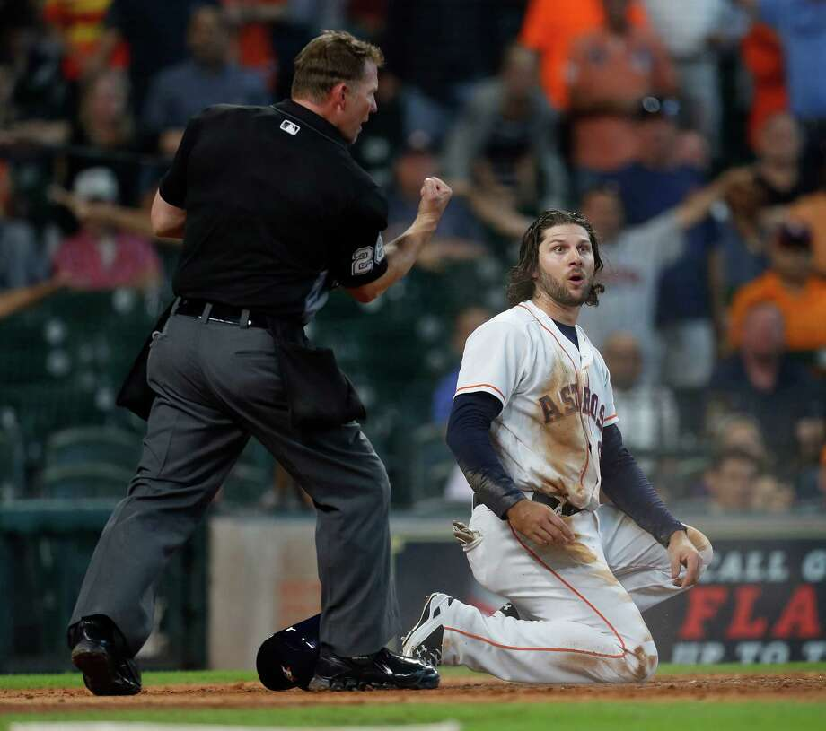 Home plate umpire Jim Wolf calls Houston Astros Jake Marisnick (6) out at home on a play later challenged and overturned during the fifth inning of an MLB game at Minute Maid Park, Wednesday, Sept. 28, 2016 in Houston. Photo: Karen Warren, Houston Chronicle / 2016 Houston Chronicle