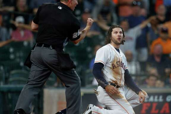 Home plate umpire Jim Wolf calls Houston Astros Jake Marisnick (6) out at home on a play later challenged and overturned during the fifth inning of an MLB game at Minute Maid Park, Wednesday, Sept. 28, 2016 in Houston.