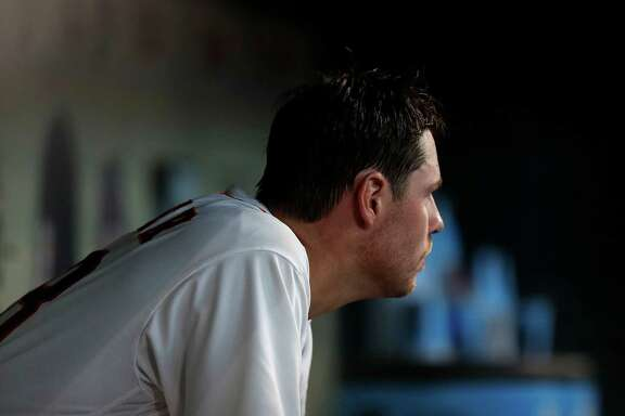 Houston Astros starting pitcher Doug Fister (58) sits in the dugout as he watches relief pitcher Kevin Chapman during the second inning of an MLB game at Minute Maid Park, Wednesday, Sept. 28, 2016 in Houston.