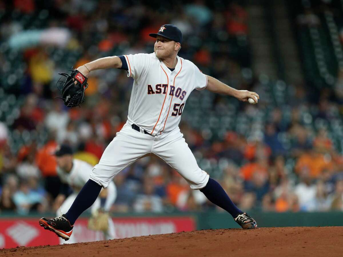 Houston Astros relief pitcher Kevin Chapman (50) pitches during the second inning of an MLB game at Minute Maid Park, Wednesday, Sept. 28, 2016 in Houston.