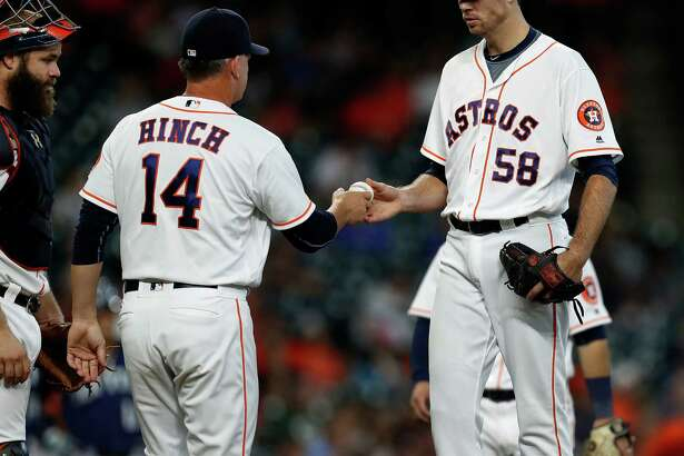 Houston Astros starting pitcher Doug Fister (58) hands the ball to the manager A.J. Hinch (14) as he gets pulled out of the game during the second inning of an MLB game at Minute Maid Park, Wednesday, Sept. 28, 2016 in Houston.