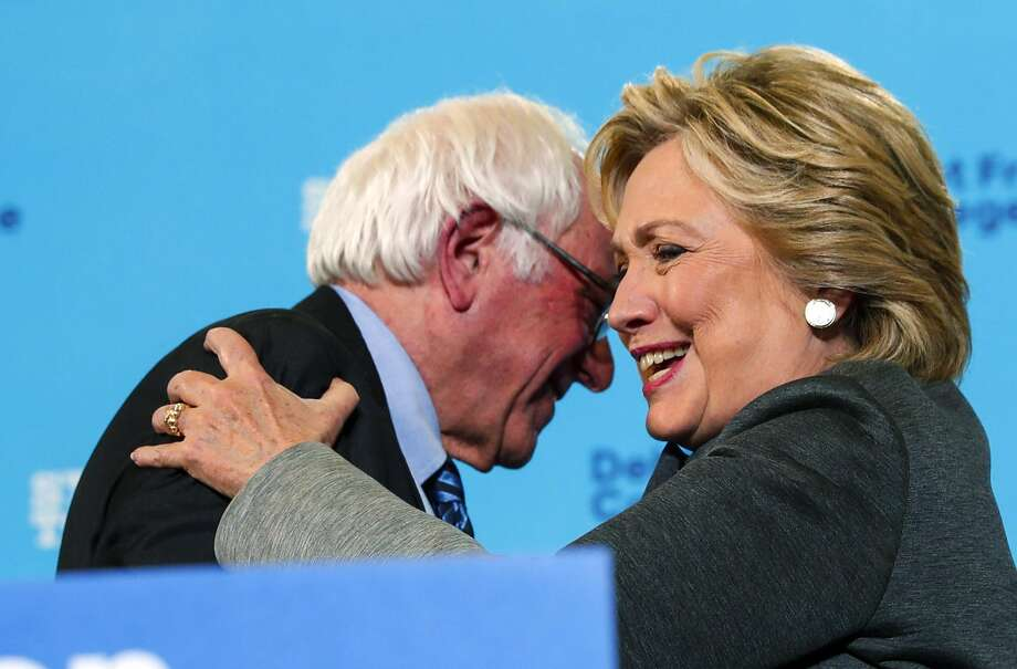 Sen. Bernie Sanders and Hillary Clinton hug during her campaign event at the in Durham, N.H. Photo: DOUG MILLS, NYT