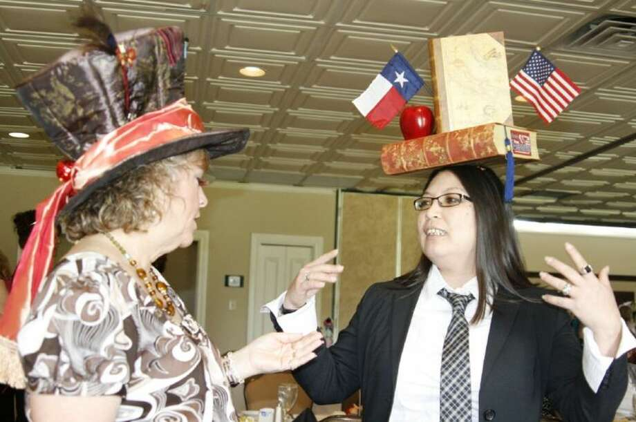 Two guests. Nancy Foisner, left; and Cherrie Ledoux, right; at a past Mad Hatter's luncheon show off their hats. This year's event is April 18.