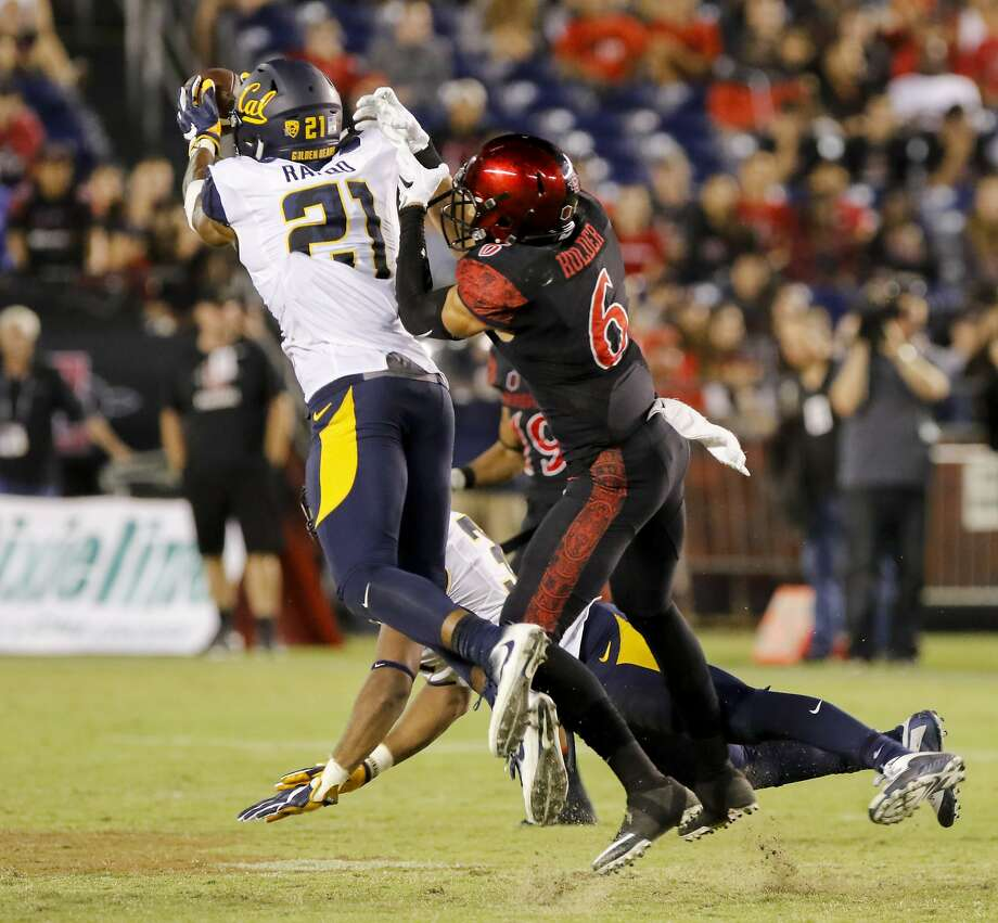 Cal's Evan Rambo makes an interception in front of San Diego State's Mikah Holder in a Sept. 10 loss. Rambo is the latest LB to go down. In all, six Cal defensive backs are hurt and un able to play against Utah. Photo: Don Boomer, Associated Press