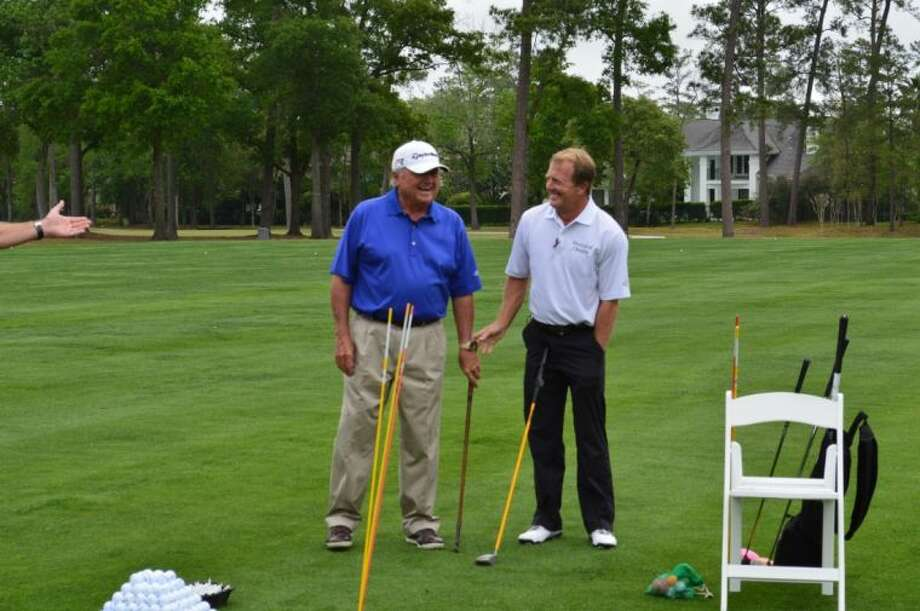 Professional golfer Fred Funk, right, gave a clinic Monday at The Woodlands Country Club, the site for the 10th Annual Insperity Championship.