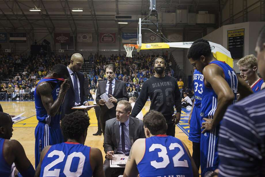 "Baron Davis, center, in between plays during a game between the Santa Cruz Warriors and the Delaware 87ers, the team Davis now plays for, at the Kaiser Permanente Arena in Santa Cruz, Calif., March 13, 2016. Nearly four years since he tore up his right knee in a playoff game for the New York Knicks, Davis has resurfaced on the basketball margins. ""It's almost like being a rookie again,"" said Davis. (Jason Henry/The New York Times) Photo: JASON HENRY, NYT"