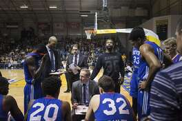 Baron Davis, center, in between plays during a game between the Santa Cruz Warriors and the Delaware 87ers, the team Davis now plays for, at the Kaiser Permanente Arena in Santa Cruz, Calif., March 13, 2016. Nearly four years since he tore up his right knee in a playoff game for the New York Knicks, Davis has resurfaced on the basketball margins. �It�s almost like being a rookie again,� said Davis. (Jason Henry/The New York Times)