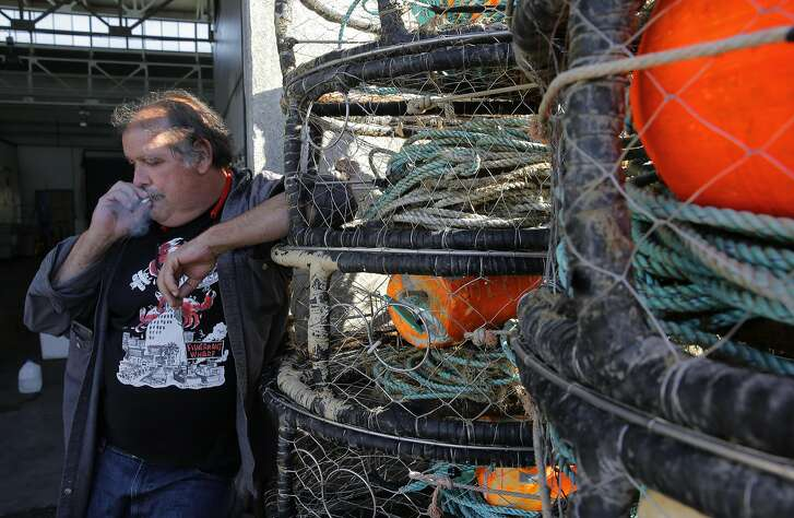 Larry Collins, the president of the San Francisco Community Fishing Association stands near crab pots on Pier 45 in San Francisco, Calif. on Thurs. November 5, 2015.