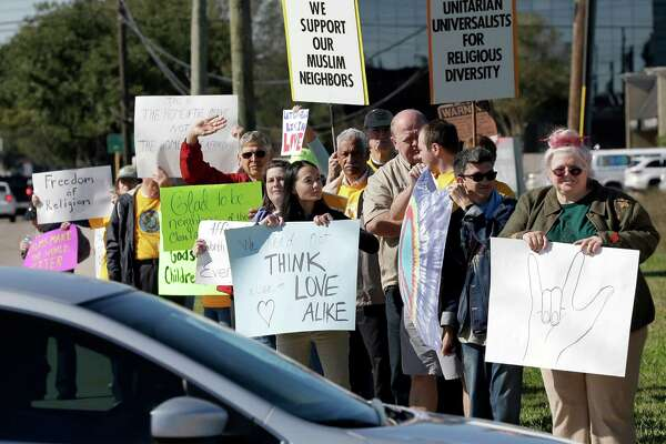 People  rally to support Muslim members of the community in Webster on Dec. 4. Their sentiments clash with those of Gov. Greg Abbott's threat to withdraw Texas from the refugee resettlement program.