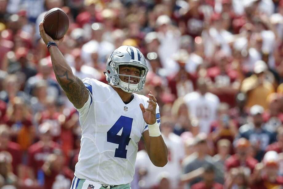 Cowboys quarterback Dak Prescott has some wondering if he might be better than Tony Romo. Photo: Alex Brandon, Associated Press