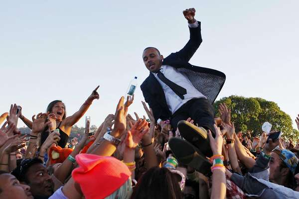Walshy Fire of Major Lazor is seen jumping into the crowd at the Treasure Island Music Festival in San Francisco, Calif. on Saturday, Oct. 19, 2013.