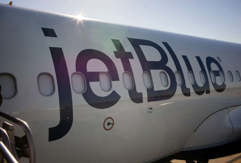 Passengers board a JetBlue Airways plane January 5, 2015 in Long Beach, California. Scroll ahead to see some of the best flight deals out of SFO.