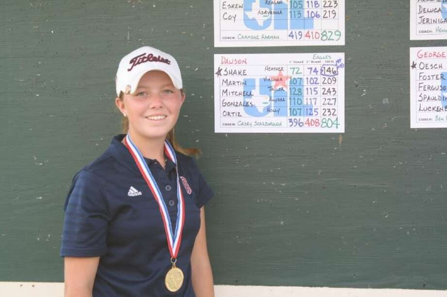 Dawson golfer Heather Shake is shown with her first place medal at the Region III-4A golf tournament where she shot 72-74--146 at Ravens Nest Golf Course in Huntsville. Photo: SUBMITTED PHOTO