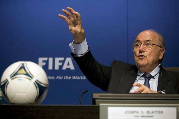 FILE - In this March 30, 2012 file photo then FIFA President Sepp Blatter gestures during a press conference at the FIFA headquarters in Zurich, Switzerland. FIFA said Thursday, March 17, 2016 Sepp Blatter was paid US$ 3.76 million in 2015, revealing his salary for 1st time  (AP Photo/Anja Niedringhaus, file)