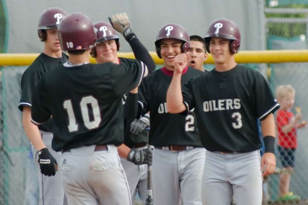 Pearland teammates (left to right) Jacob Finke, Jake Crain, Ryan Diaz (2) and Skyler Valentine (3) congratulate Connor Wong (10) after his grand slam Tuesday against Manvel.