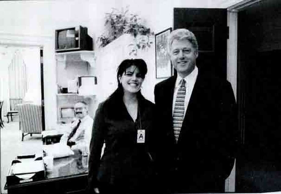 Former White House intern Monica Lewinsky and former President Bill Clinton at a White House function in the late 1999's.