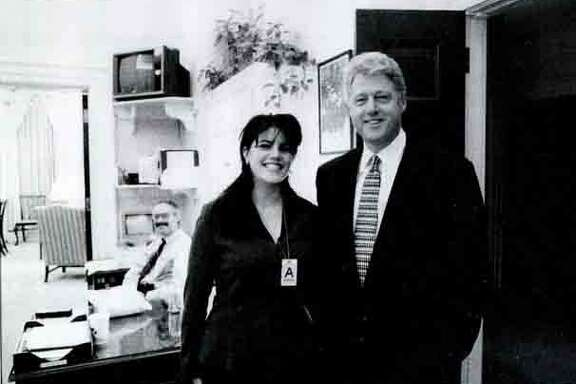 A photograph showing former White House intern Monica Lewinsky meeting President Bill Clinton at a White House function submitted as evidence in documents by the Starr investigation and released by the House Judiciary committee Sept. 21, 1998. AP