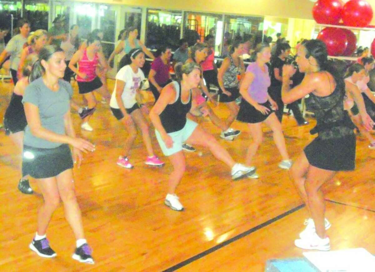 Photo by Lindsey Vaculin/The RancherTammy Harris, far right, pumps up participants in her Soul Gooves class. Harris will host Get Fit Houston Saturday morning at Jones Plaza in downtown Houston to help promote her cchoreographed cardio workout.