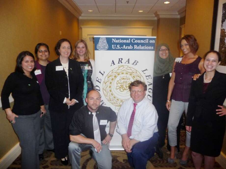 In April, seven University of Houston-Clear Lake students participated the National Council on U.S. - Arab Relations Model Arab League competition at Georgetown University in Washington, D.C. Pictured are the members of the council with two UH-Clear Lake professors including (left to right, back row) Monica Rincon of Pasadena, Nora Ventura of La Porte, Assistant Professor of Anthropology and Cross-Cultural Studies Maria Curtis, Jane Terekhova, Cindy Steffens, Andrea Strege and Kate Boggess; (kneeling, l to r) Nick Burns and Associate Professor of Sociology Michael McMullen.