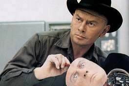 Yul Brynner plays a robotic gunslinger that runs amok in Michael Crichton's big-screen chiller 'Westworld.'  1973