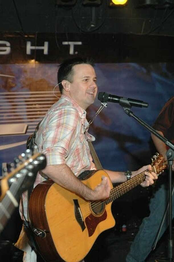 Roger Creager performing during a concert.