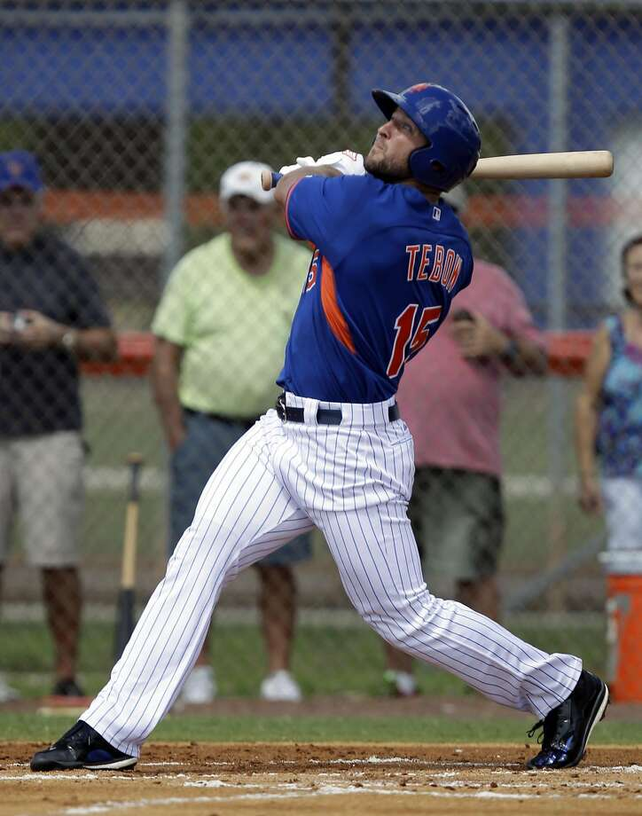 Tim Tebow hits a solo home run in his first at bat during the first inning of  his first instructional league baseball game for the New York Mets against the St. Louis Cardinals instructional club Wednesday, Sept. 28, 2016, in Port St. Lucie, Fla.  (AP Photo/Luis M. Alvarez) Photo: Luis M. Alvarez, Associated Press