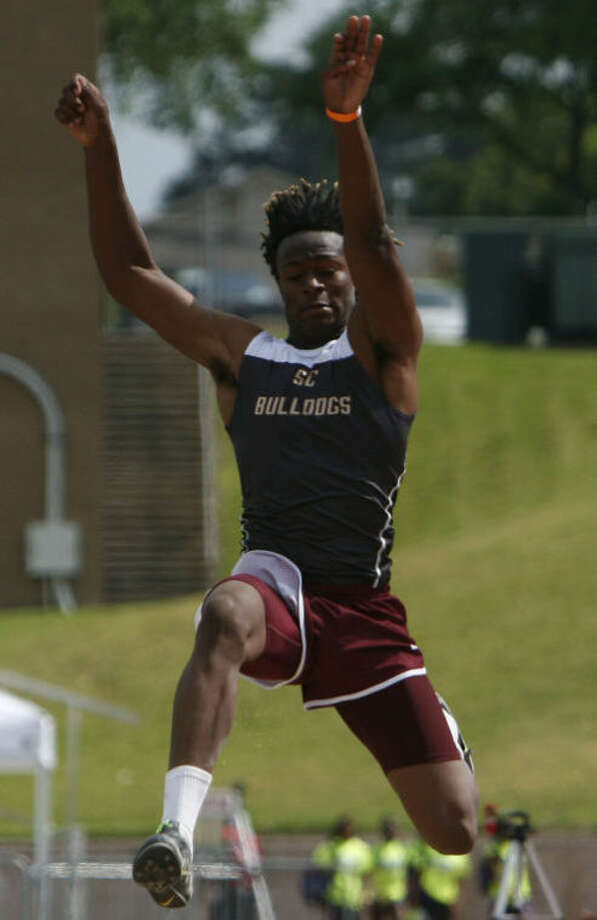 Summer Creek's Greg Hogan competes in the Boys Long Jump event on the frist day of the Region III-4A Track & Field Championships at Bowers Stadium in Huntsville. Photo: Photo By Eric Swist