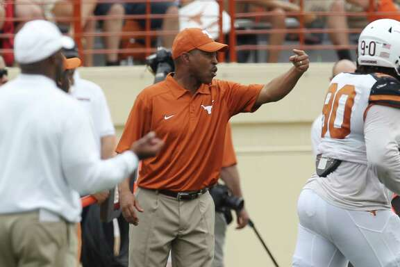 Texas Longhorn Defensive Coordinator Vance Bedford (center) gestures to his players at the 2014 Texas Football Orange-White Scrimmage in Austin on Saturday, Apr. 19, 2014. (Kin Man Hui/San Antonio Express-News)