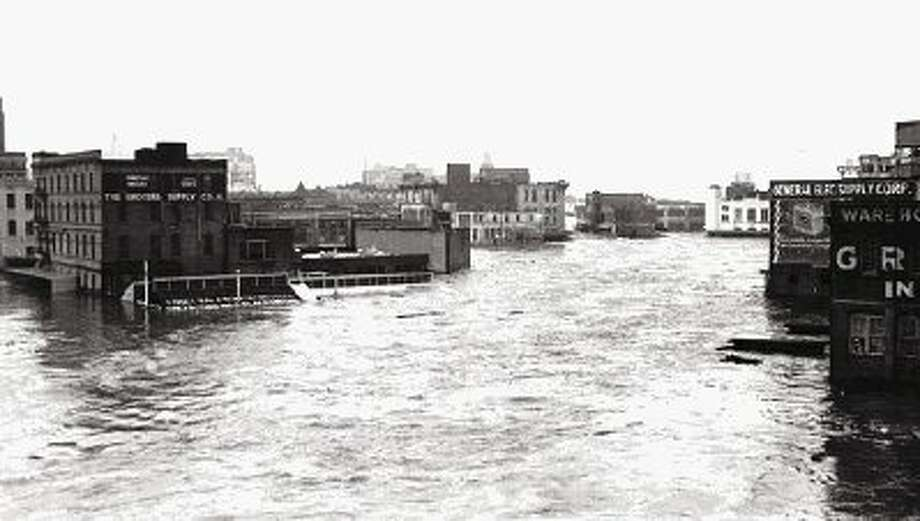 1935 Flood, downtown Houston: In December 1935, a massive rainfall event inundated Houston and Harris County causing widespread damage. Seven people lost their lives, downtown Houston (pictured here) and surrounding residential areas were flooded and the Port of Houston was crippled for months. The Great Flood of 1935 prompted Houston and Harris County leaders to pursue flood damage reduction projects and financial assistance. After local leaders submitted a petition with pictorial images of the Great Flood of 1935, the 45th Texas Legislature passed the bill that created the Harris County Flood Control District in 1937.