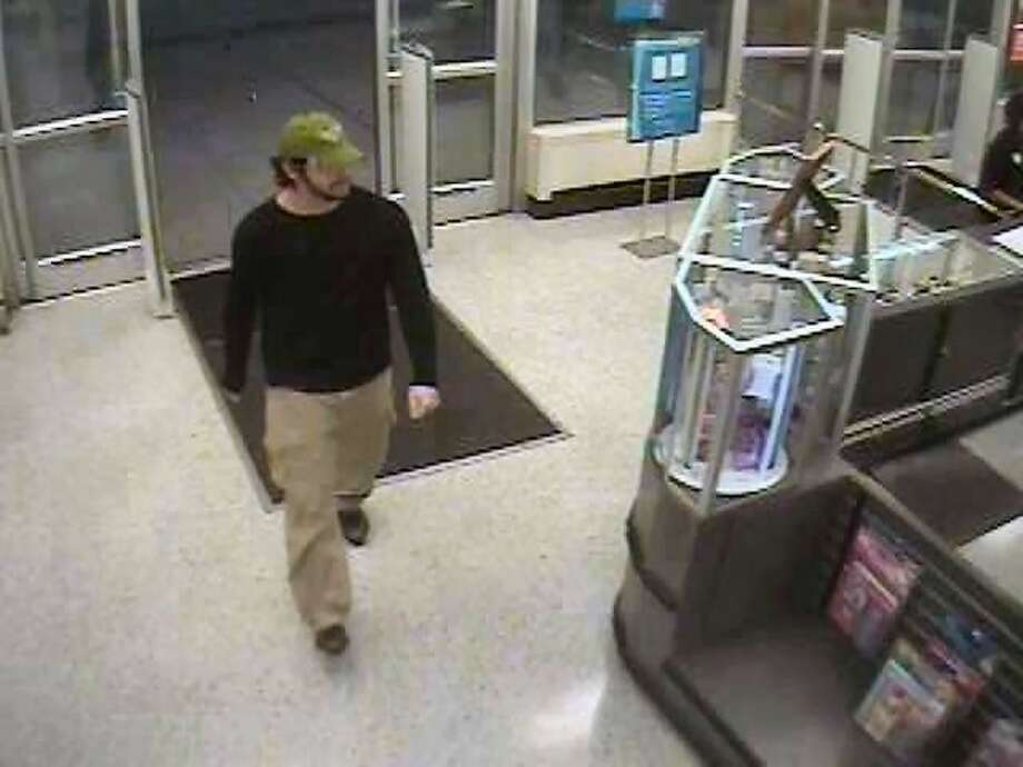 This man shown in the surveillance still is one of two men being sought in connection with a fire deliberately set Sunday evening at the Ross Dress for Less store located at FM 2978 and FM 1488 in the Magnolia area.