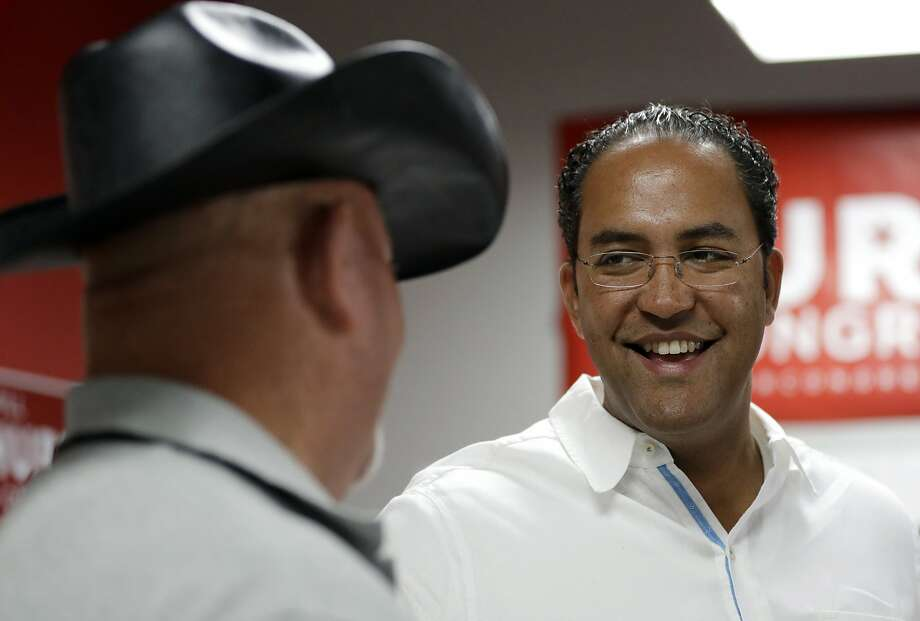 In this Aug. 27, 2016, file photo, first-term Republican Rep. Will Hurd, right, of Texas, talks with a supporter. Thanks to gerrymandering, Hurd is involved in the only competitive congressional race in Texas. Keep clicking to take a look at just how gerrymandered Texas' districts are.  Photo: Eric Gay, Associated Press