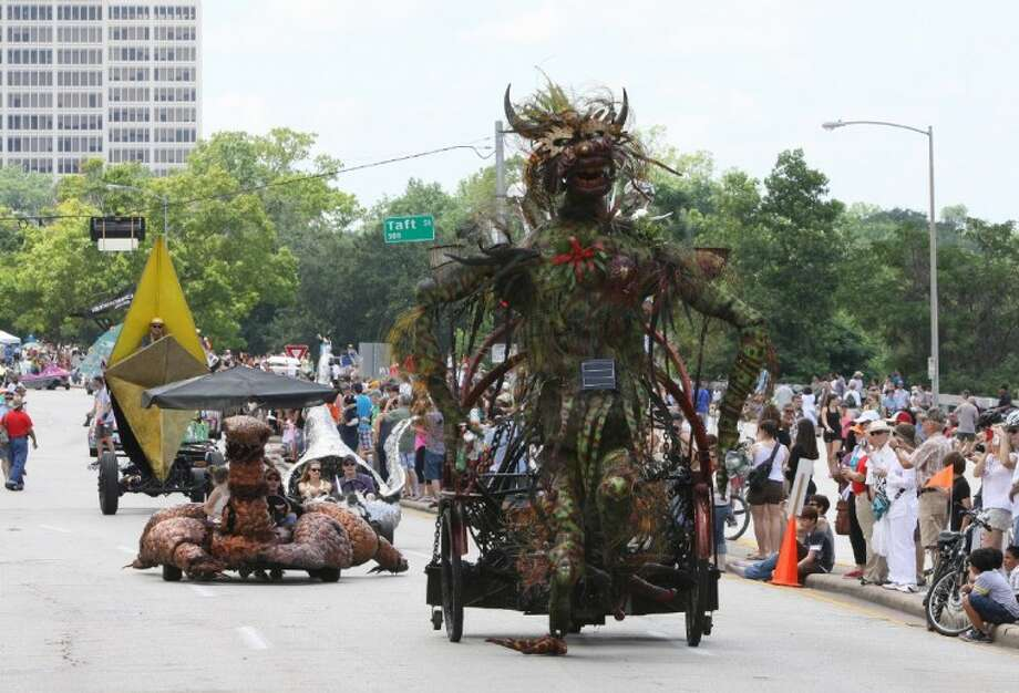 Entries move down Allen Parkway during the 2012 Art Car Parade in Houston. Photo by Alan Warren/Houston Community Newspapers Photo: Photo By Alan Warren
