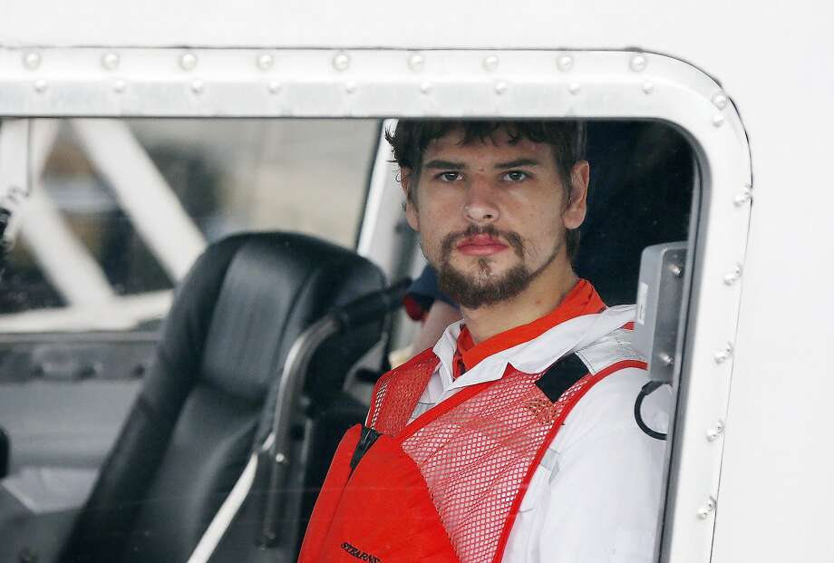 Nathan Carman arrives in a small boat at the US Coast Guard station in Boston, Tuesday, Sept. 27, 2016. Carman spent a week at sea in a life raft before being rescued by a passing freighter. (AP Photo/Michael Dwyer) Photo: Michael Dwyer, Associated Press