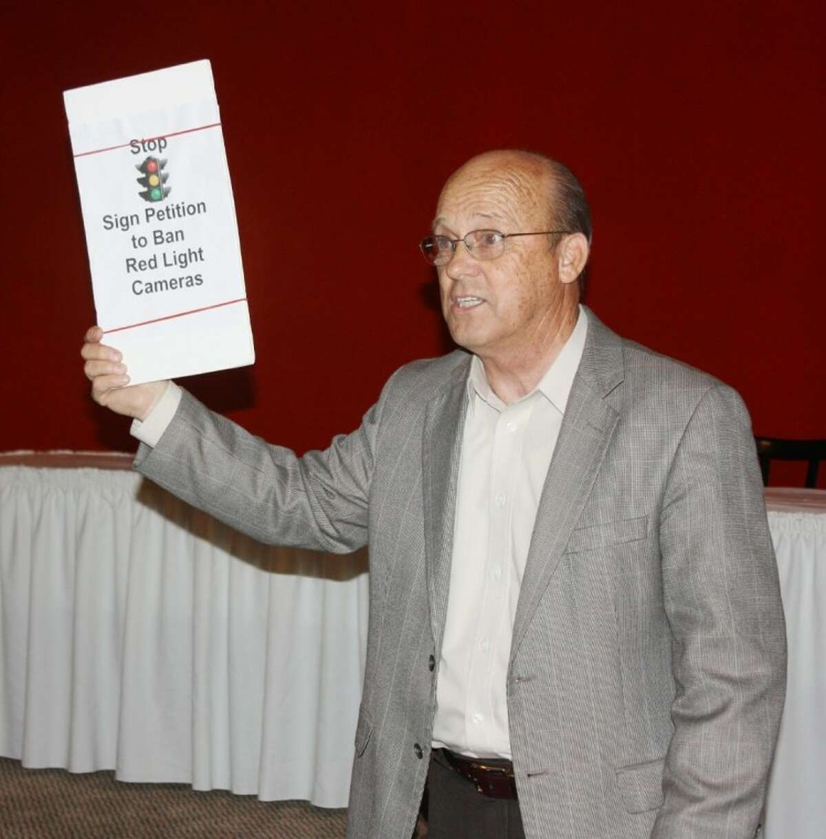 Aubrey Vaughan, co-founder of the Tri-County Texas Tea Party, encouraged Cleveland residents and Tea Party members to sign a petition that would remove the city's red light camera system.