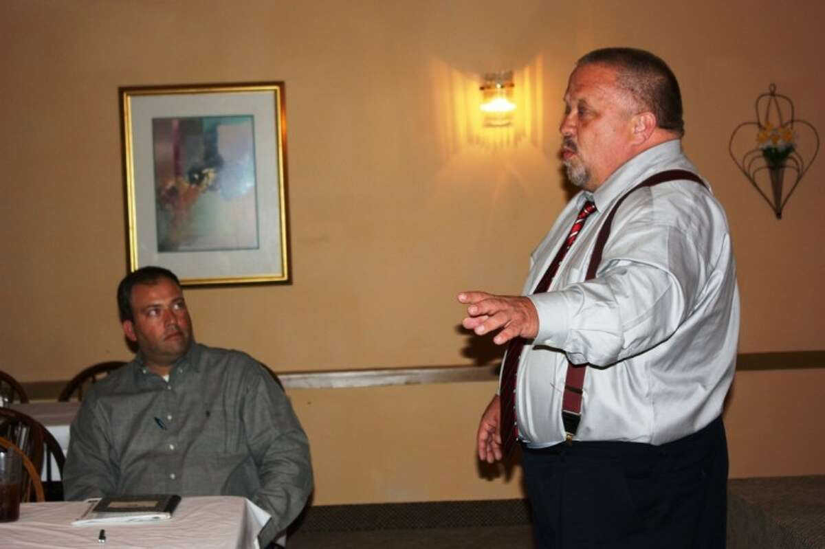 Attorney Paul Kubosh, right, and Byron Schirmbeck, a citizen activist and director of Citizens for Safer Streets, are assisting the Tri-County Texas Tea Party in their efforts to remove Cleveland's red light camera system. They have helped other cities with the same effort such as College Station, Houston and Baytown.
