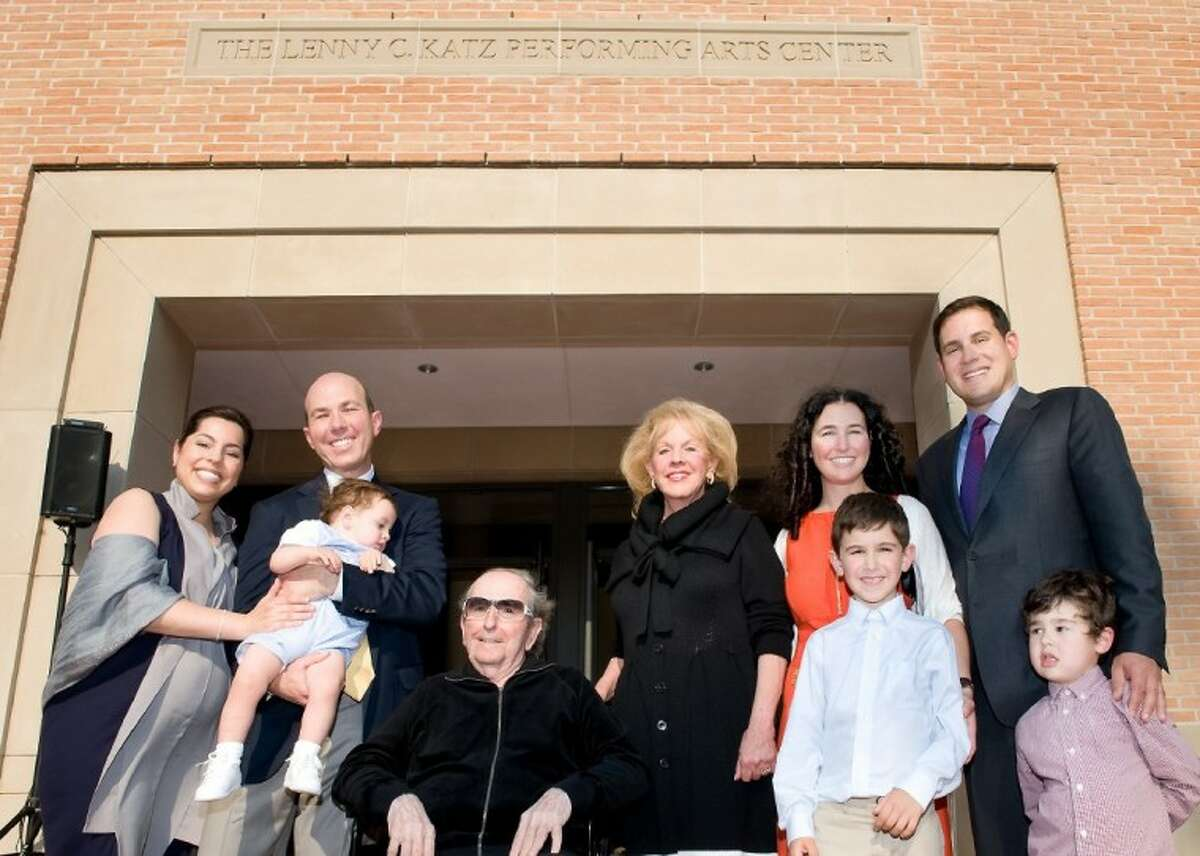 Nicole and Evan Katz (left) holding their son Sam, Jerold B. Katz, Judy Katz, Lissy Katz Bank, her husband Josh Bank, and their sons Moses and August, in front of the Lenny C. Katz Performing Arts Center at Kinkaid.
