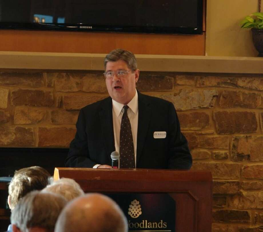 James Moeller, financial adviser with Outlook Financial Group LLC, prepares to introduce ambassador Robert M. Kimmitt during a presentation at The Woodlands Country Club April 23.