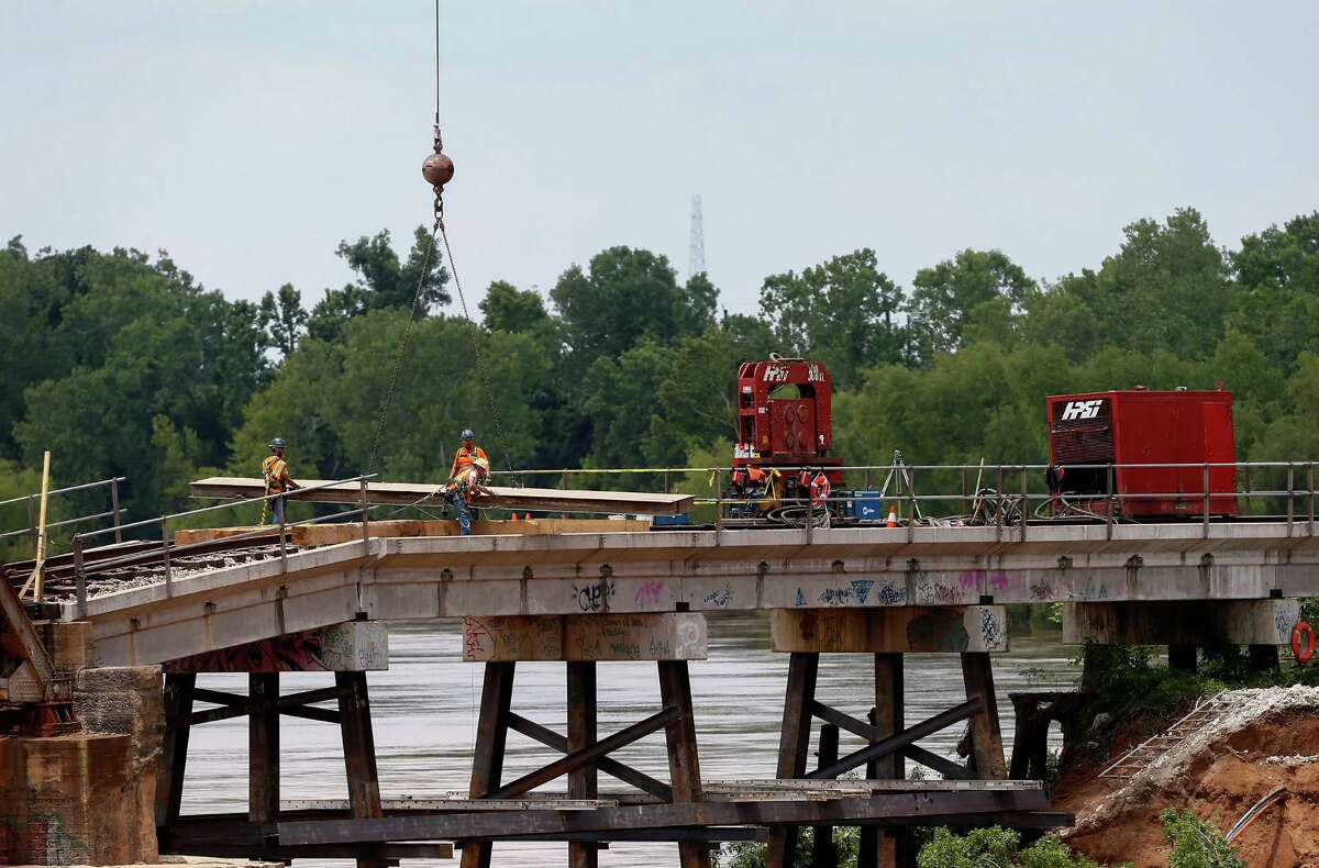 Union Pacific workers in June began repairs on a Brazos River bridge that would be used by light rail.