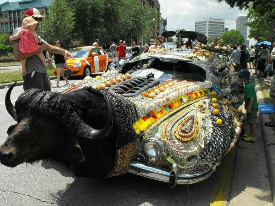 """David Best, a professional art car artist, designed """"Faith,"""" which is housed at the Art Car Museum."""