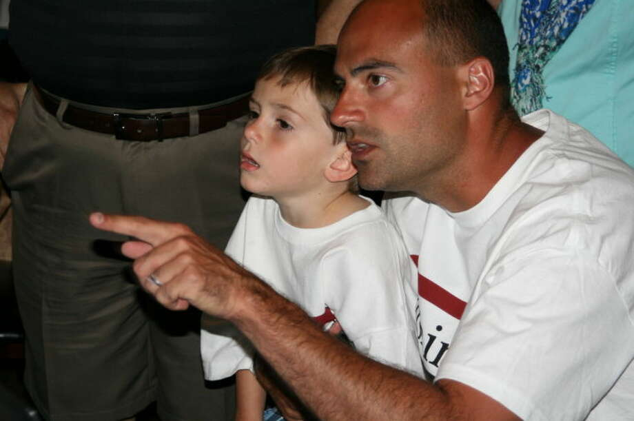 Heath Rushing explains the results to son, Graham, at his watch party May 11, 2013. Photo: By Jennifer Summer