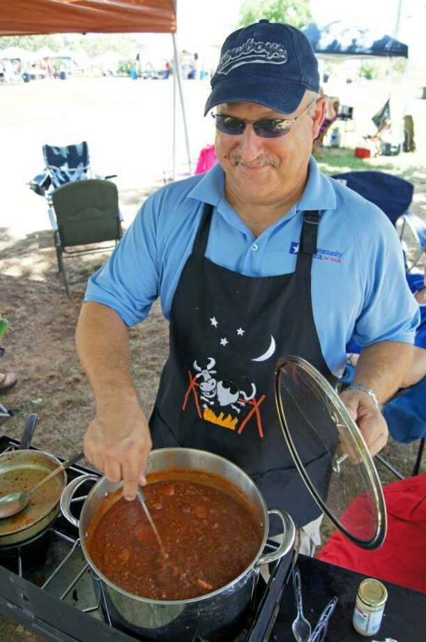 Mark Clark, a member of Team Community Bank of Texas-Tomball, voted Best Chili in Tomball 2012 during last year's competition Photo: Submitted