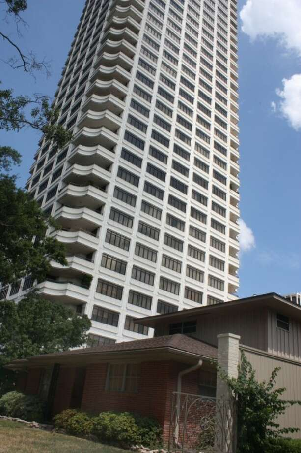 A turbulent 2011 behind it, Houston will look at limiting how close high-rises can be built to houses.