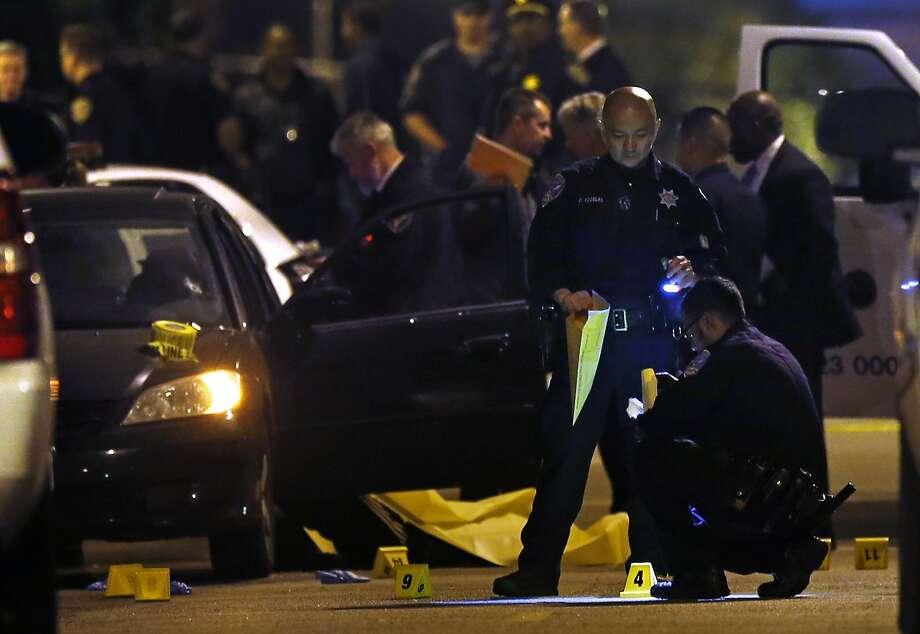 San Francisco Police investigate a quadruple homicide on Laguna Street near Page Street on Jan. 9, 2015. Photo: Scott Strazzante, The Chronicle