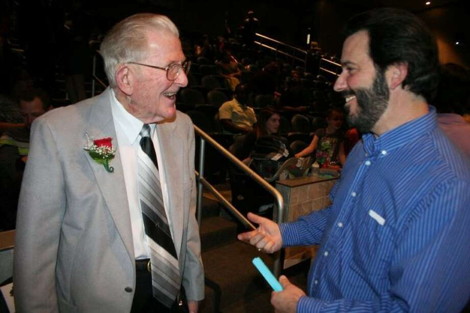 "Doug Love, left, visits with a fellow teacher at last year's Just About Kids ""For the Love of Music"" event. Love died at the age of 90 May 2013 after complications from surgery. The event was named in honor of him."