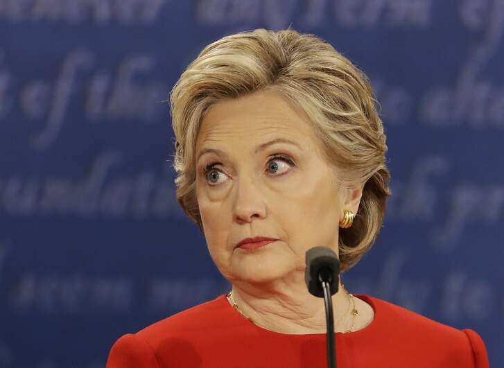 Democratic presidential nominee Hillary Clinton listens to Republican presidential nominee Donald Trump during the presidential debate at Hofstra University in Hempstead, N.Y., Monday, Sept. 26, 2016. (AP Photo/Julio Cortez)